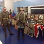Sam Trying on the clothing a soldier would have worn in the great war