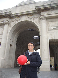 Veronic receiving the Peace Poppy Footballs at Menin Gate, Ypres. to deliver to Ghana.