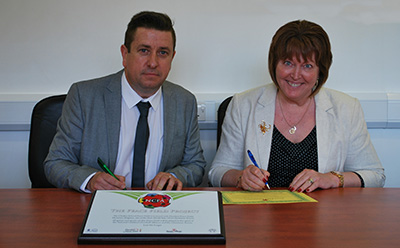L-R. Ernie Brennan, Director, NCFA and Leslie Young, Head Teacher, Chailey School, signing the Peace Field Project Declaration.