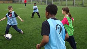 Balls and Girls playing football